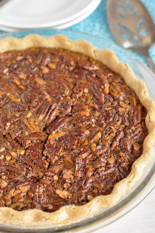 whole uncut Gluten-Free Pecan Pie on table ready to cut and serve