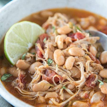 close up at angle Instant Pot White Bean Chicken Chili in Bowl