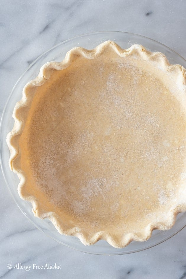 unbaked raw gluten-free pie crust in pie pan, ready for filling