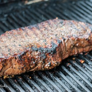 london broil cooking on grill