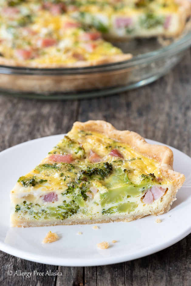 slice of gluten-free quiche sitting on white plate