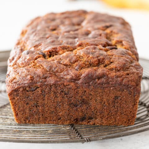 whole gluten-free banana bread loaf sitting on cooling rack