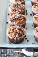 paleo banana muffins sitting on light blue metal pan