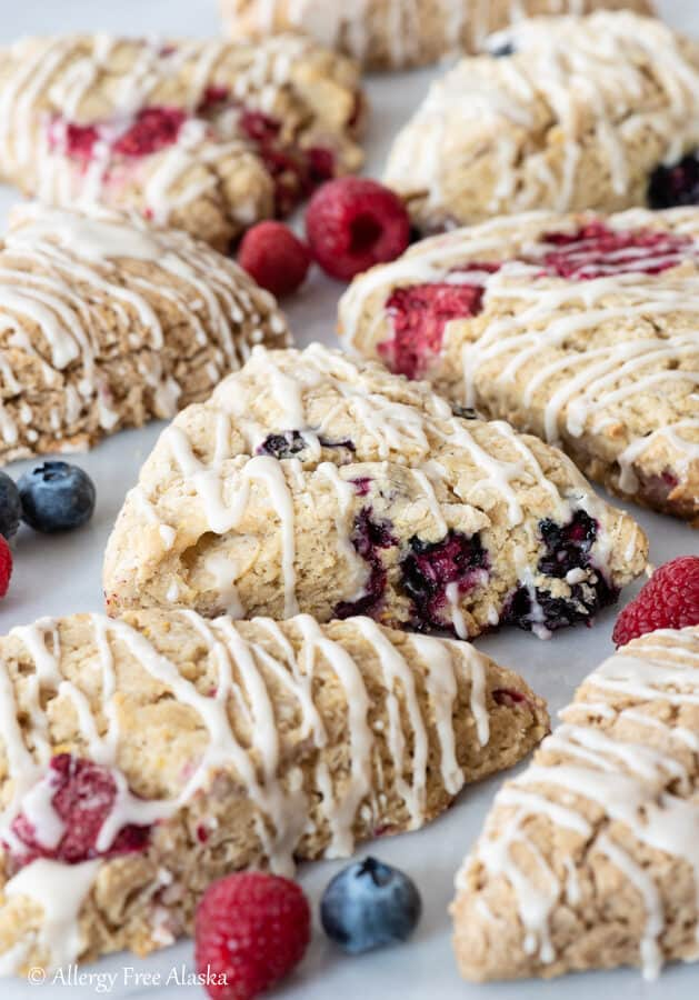 gluten free scones sitting on pastry board with berries